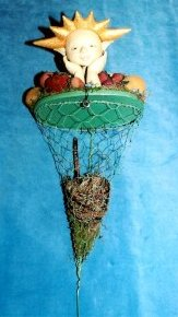 "Sewing Pattern - Unique 8"" Soft sculpture basket topper doll surrounded by fruits and vegetables."