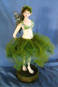 "Enchanting 15"" fairy with feather hair, delicate beading and a billowing tulle skirt."