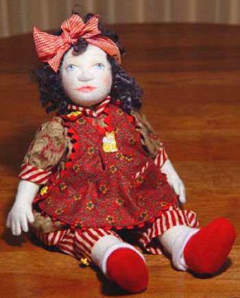 "Sweet 12"" button-jointed, felt baby doll with chin gusset and needle sculpted features."