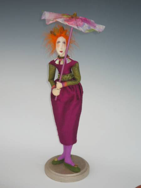 "This graceful 18"" figure carries a beautiful parasol to keep the color in her hair and off her skin."