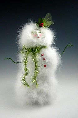 "With a little bit of paper mache, paper clay, painting, wire bending and pin pushing you can create this truly marvelous 12"" snow gal."