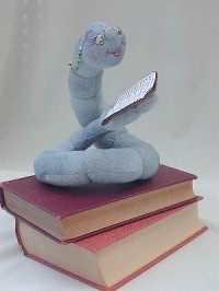 "Milton, a bookworm who loves to read, sits 6"" high and is easy to make."