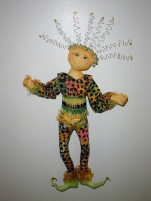 "This whimsical 16"" wall doll with wild hair and many embellishment options is fun and fast to sew"