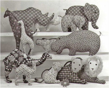 Easy to make pillow toys: 6 mamas—Rhino, Elephant, Giraffe, Hippo, Camel, Lion; 6 babies (same), and 1 papa Lion.