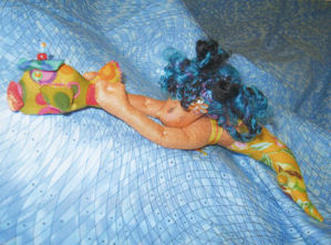 "This easy 9"" mermaid is having great fun being towed around by her colorful"