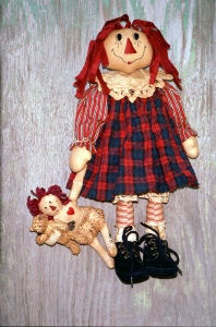 "The instructions for this sweet 19"" raggedy includes directions for turning a pre-made 8"" muslin doll body into a mini raggedy for her to carry. The mini-raggedy holds a store bought 4"" chenille bear."