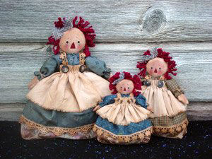 "These darling raggedies in three sizes - 5"", 6"" and 8"" - are hiding potpourri in their underskirts. Charming gift idea!"