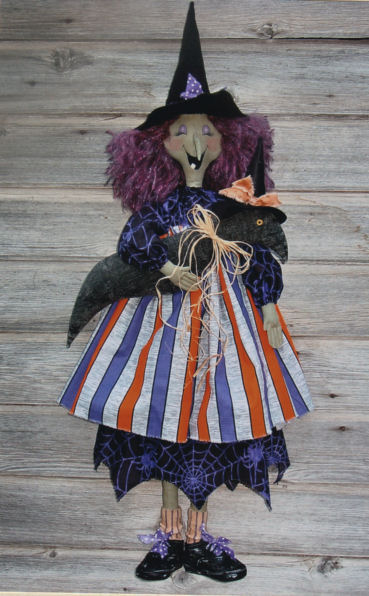 "This grand 38"" witch with her pet crow is brimming with personality."