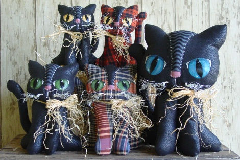 "Easy to make kitties with stitched and painted faces in three sizes – 10"", 7"" and 5""."