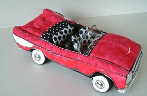 "This totally cool 1950's style car made from cloth, has a trunk to hold goodies, wheels that turn and a big V8 engine for Pete to tune up. Car measures 16"" long, 8"" wide and 3.5 "" high.  Pattern Available"