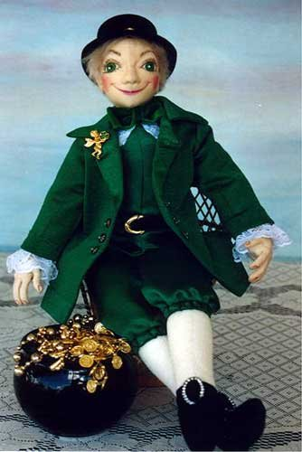 "16"" tall and handsome to boot, this lucky leprechaun wears a green shirt, stylish coat, lace collar and cuffs set off with jaunty gold buckles at his waist, shoes and on his hat."