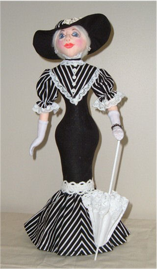 "This gorgeous 16"" stump doll is all dressed up and off to the races. Pattern includes, hat, parasol and gloves as shown in picture."