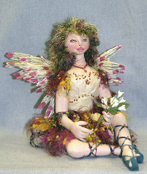 "9"" seated fairy is arrayed in flower petals, soft leather beaded shoes and wild yarn hair. - Doll Pattern"