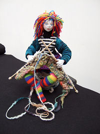 "The costume for this wonderful 15""wire wrapped doll can either be knitted or sewn from old knitwear. You'll need 1/4 yard of a knit fabric for the head and hands. Clear photos and diagrams teach you this fabulous method of dollmaking."