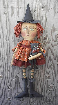 "usty safety pins form the elbows and knees of this 36"" witch holding an 11"" cat."