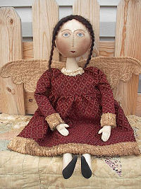 "Lovely 25"" vintage style doll with quilted wings and chenille trim on her dress."