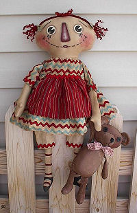 "This sweet 22"" raggedy is never without her 11"" bear."