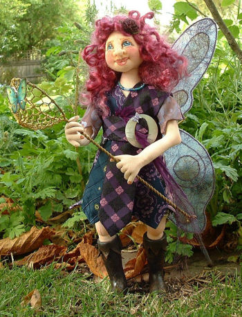 "Flurrie - fantastic 12"" free-standing fairy has a needle sculpted face, fiber wings and wonderful paperclay boots. Pattern includes a CD with detailed construction photos."