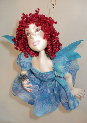 "This 14"" flying Tooth Fairy is constructed so she moves making her look like she is in flight!"
