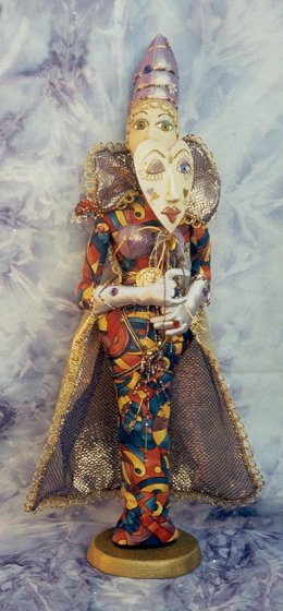 "This beaded 24"" futuristic diva holds a sculpey mask."