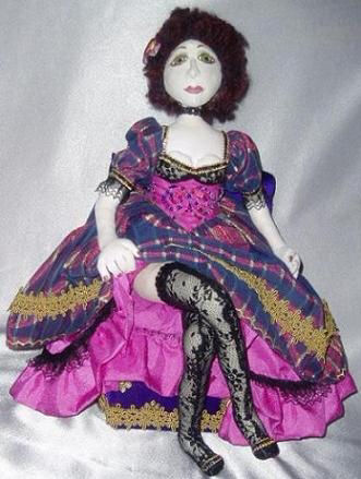 "Black lace, ruffles and trim adorn this very sexy 17"" needle sculpted doll."