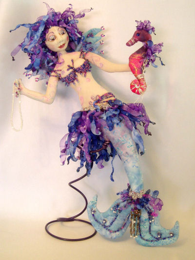"You'll have a ball beading and burning up strips of organza to embellish this fabulous 17"" mermaid walldoll with her seahorse."