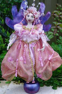 "Tons and tons of photos will guide through every step of creating, dressing and embellishing this beautiful 16"" armatured fairy with an overlay face."