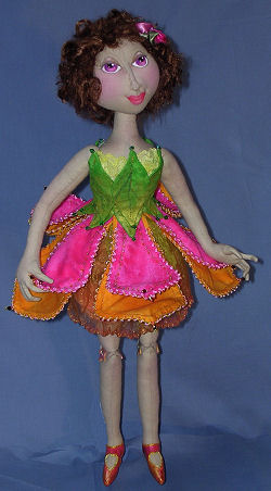 "18"" flower fairy has button jointed legs, needle sculpted features and a costume fashioned from wired and beaded petals."