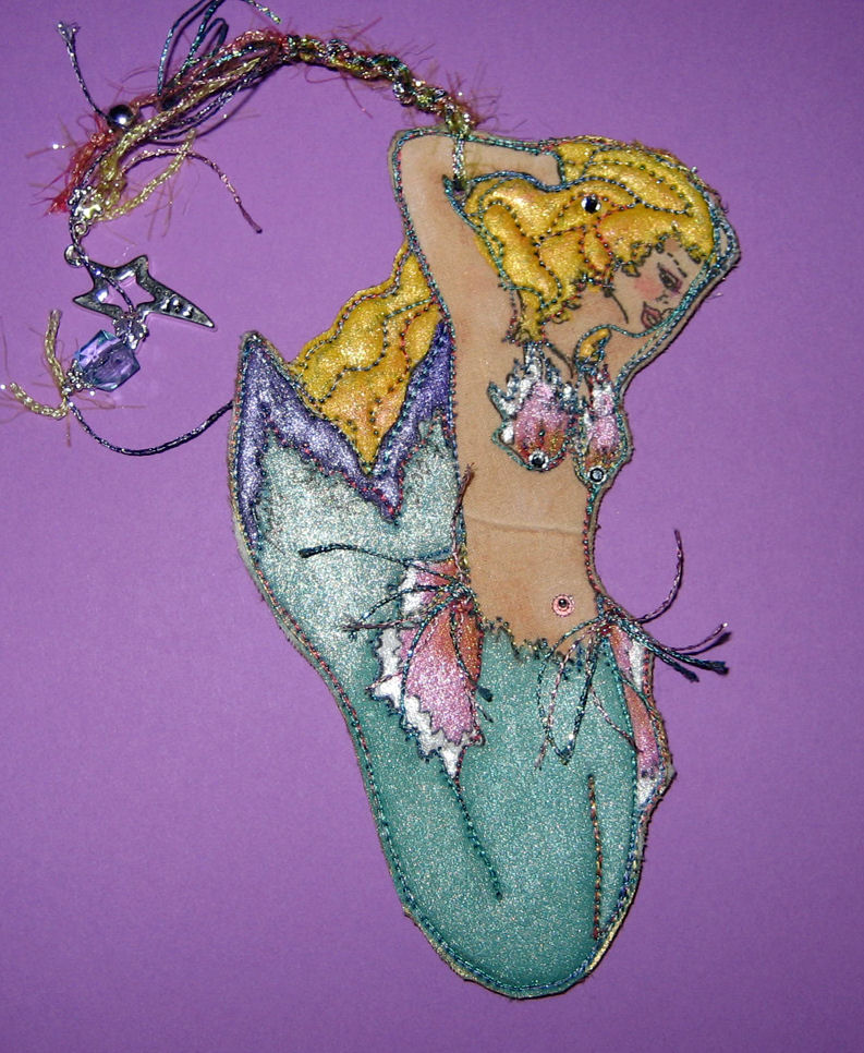 "This 5"" mermaid stamp can be made into a tag, or used for ATCs, postcards, suface embellishment, scrapbooks and more."