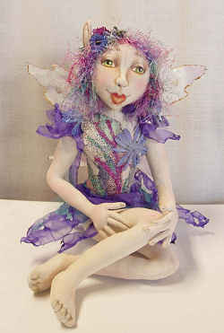 "15"" seated fairy is dressed in singed organza and tulle. Cloth Sewing Pattern Available"