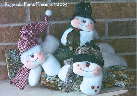 "A little bit of Warm-n-Natural and a few fabric scraps are all you need to whip up these darling laying snowmen in 3 sizes – 7"", 9"" and 12""."