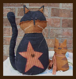 "These rustic, weighted 15"" cat and 8"" kitten would make great doorstops."