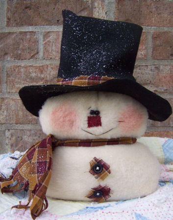 "This super quick and easy plush felt snowman stands 12"" tall without his hat."