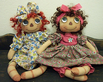 "These 14"" raggedies have quite a retro look in their floral print dresses."