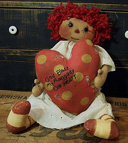 "This gentle 20"" raggedy is holding her patched up heart in her hands."
