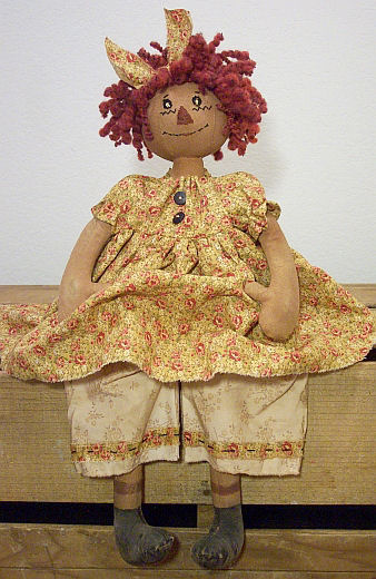 "This lovely 15"" rag doll has a round head and embroidered features."