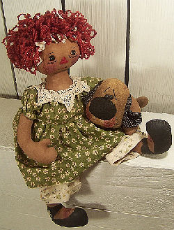 "Gentle 16"" raggedy with red Ricky Wacky hair loving her primitive puppy."