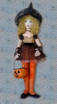 "This delightfully stylish 18"" trick-or-treater has lace gloves, beaded accessories and a darling pumpkin to hold her goodies."