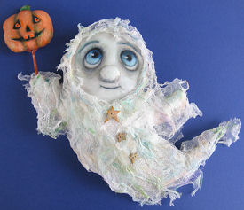 "Pattern to Sew a 13"" ghost dressed in stiffened cheesecloth is holding a painted pumpkin wand."