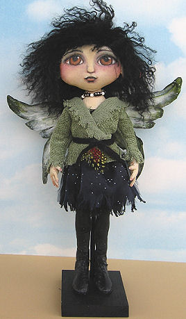 "Tyvek wings and boots adorn this very cool 16"" painted fairy."