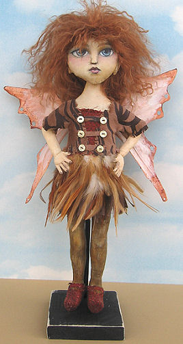 "A wonderful feather skirt and tyvek wings give this sassy 16"" fairy lots of flair."