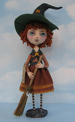 "A clay base and wooden dowels support the body of this sweet 16"" witch."
