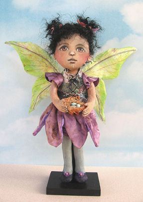 "wings of this pretty 12"" fairy wearing a tapestry vest over a petal skirt are painted silk."