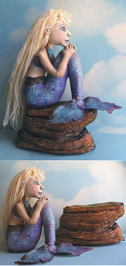 "This pensive 6"" x 8"" painted muslin mermaid is made to sit on or off her rock which is made from plaster wrap and then painted."