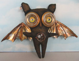 "You'll be cutting up some aluminum drink cans to form the eyes and wings of this 11"" x 13"" Steampunk Bat."