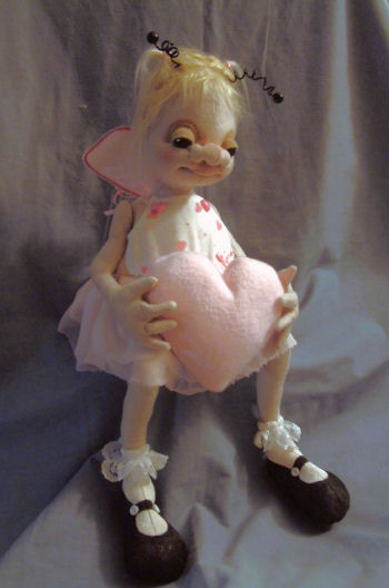 "This sweet little girl bug with a weighted bottom sits 8"" high. Cloth Doll Pattern"