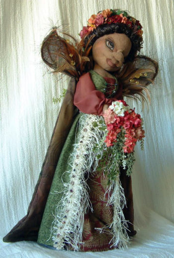 "Silk flowers, vines , feathers and more adorn this graceful 17"" doll built over a wooden candle stick or a dowel and disk. Doll Making Sewing Pattern"