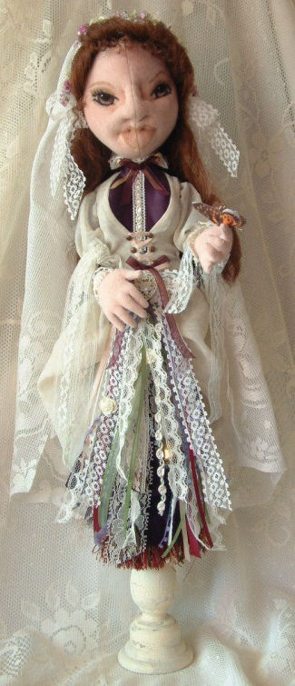 "Built over a candle stick this 20"" bride doll has an ethnic flair."