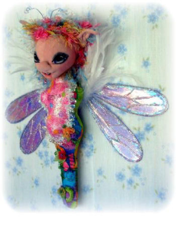 "You'll have so much fun embellishing this colorful 14"" fairy wall doll that features an open mouth. Shelley's step-by-step construction photos are simply fantastic!"