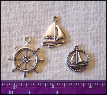 Steampunk Trinkets - Nautical Theme for Art Dolls - Silver sailboat, ship's wheel, & rope circle sailboat
